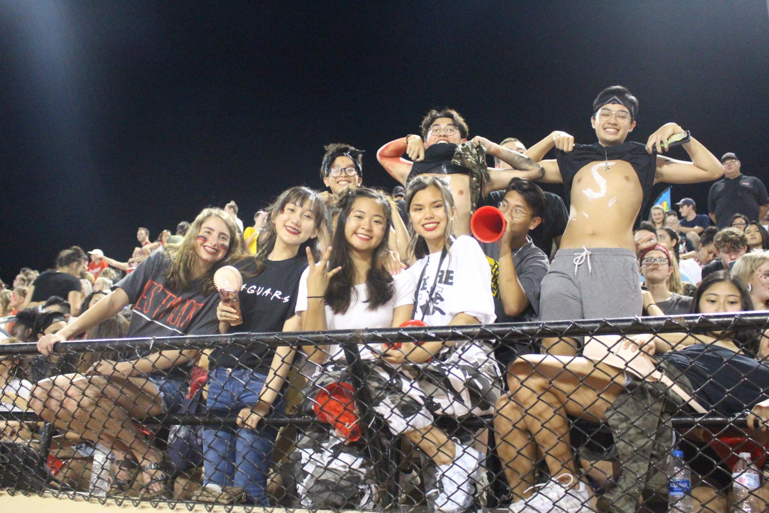 Westmoore students show their school spirit at the front of the student section. Wearing school colors, they shout their hearts out at the biggest sports game of the year, Moore War, the game between sports rivals Moore and Westmoore High School.