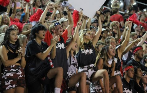 BLEACHER CREATURES Seniors Louis Nguyen, Trever Berdinner, Hayden Jeffries, Zoe Curtis, Allie Thompson, and Kailyn Stonebraker made their way to the front row of the student section to lead the crowd in chants at Moore War.