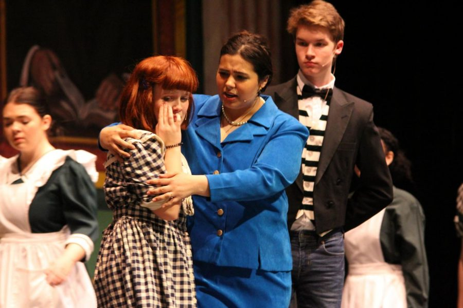 Playing Annie, sophomore Julia Gunter cries into the arms of Grace, played by junior Brylea Cloud.