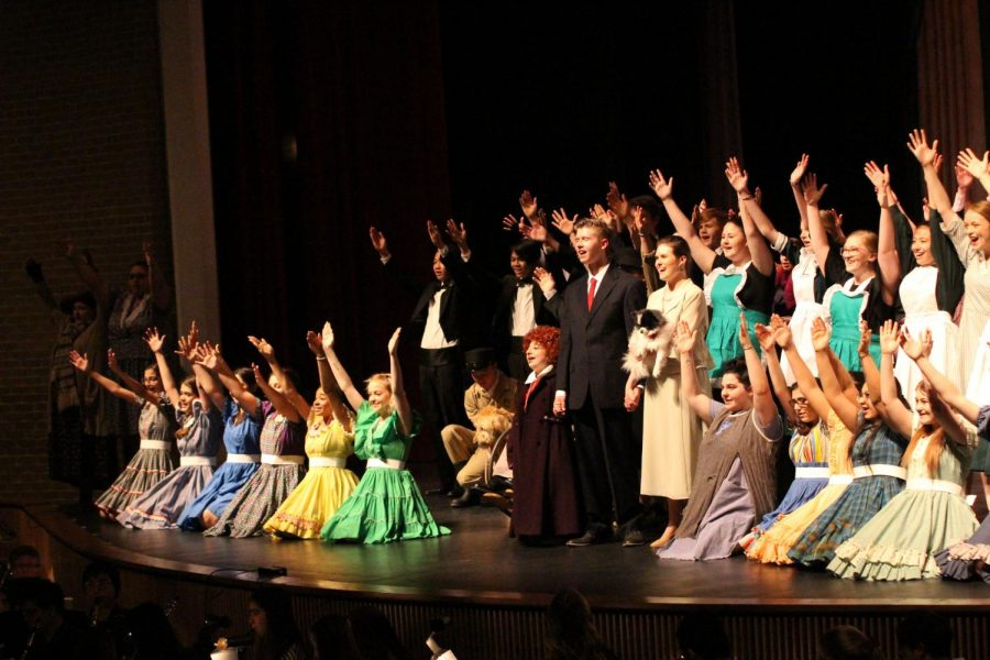 On closing night of the spring musical, the entire theatre company wave to the audience before curtain calls.
