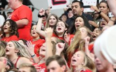 Seniors Jessica Logan and Meleah Potter chant highly and proudly during the Moore War assembly.