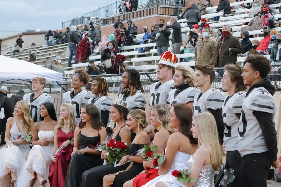 The Homecoming Court smiles for a photo after the crowning of king and queen.